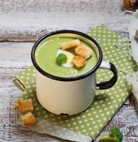 Green broccoli cream soup with croutons