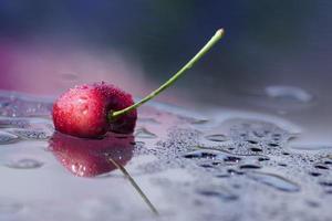 Splashing cherry, reflection surface, minimalism
