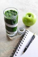 Healthy smoothie. Avocado, parsley, apple, spinach. photo