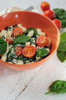 Salad with pasta, spinach, tomatoes cherry and ricotta on white