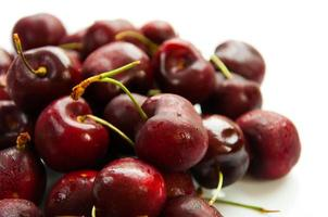 Fresh cherries isolated on white background photo