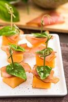 Proscuitto and cantaloupe skewers photo