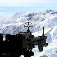 military helicopter with machine gun