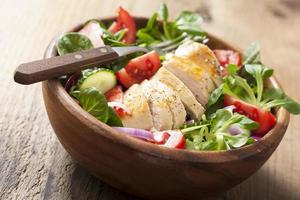 chicken salad with tomatoes and cucumber photo