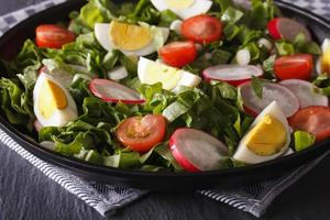Salad with eggs and spring vegetables close-up, horizontal photo