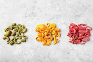 Different colorful handmade pasta variety Copy space photo