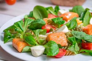 Closeup of salmon with vegetables and lettuce photo