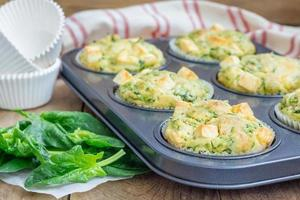 Freshly baked snack muffins with spinach and feta cheese