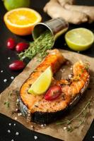 Grilled salmon fish with lime, thyme and orange
