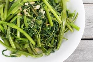 Vietnamese stir fried morning glory vegetable photo