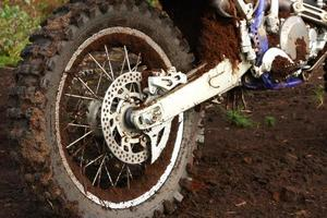 Muddy rear wheel of dirt bike