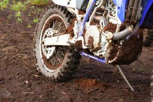Muddy rear wheel of dirt bike photo