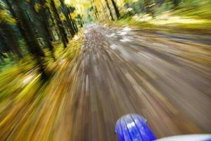 Riding dirtbike. Abstract motion blur. photo