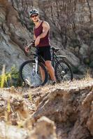 athlete man cycling on a bicycle photo