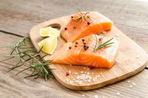 Raw salmon steaks on the wooden board photo