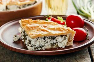 homemade pie with feta cheese and spinach