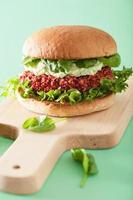 veggie beet and quinoa burger with avocado dressing