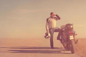 Biker chasing the sun photo