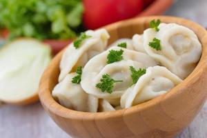 Meat pelmeni with butter photo