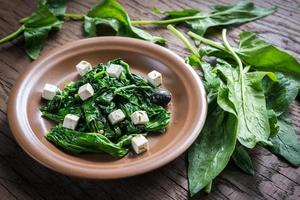 Spinach with cheese and olives photo
