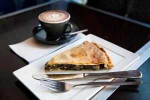 Spinach pie and coffee with heart