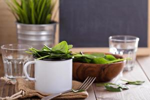 Green spinach leaves in a mug photo