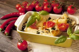 Pasta with mushrooms, vegetables  and sauce photo