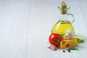 Olive oil, cheese and vegetables photo