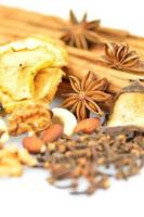 Christmas spices, nuts and dried fruits on white background