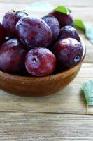 Ripe plums in a bowl photo