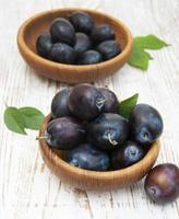 Fresh purple plums photo