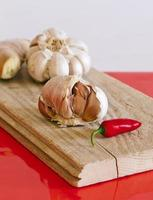 Garlic bulbs, chilli pepper and ginger photo