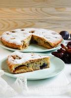 cake with plums and grapes