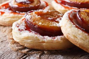 Cakes of puff pastry with plums macro horizontal photo