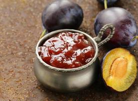 natural organic plum jam with fresh berries photo