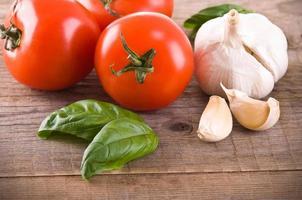 Tomatoes, garlic and basil. photo