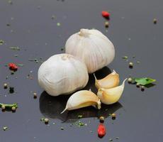 Garlic on black background. photo