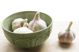 Garlic cloves on the table photo