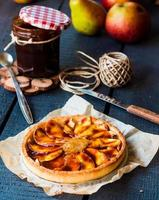round apple tart with pear jam and caramel, vertically