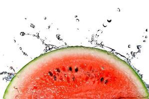 Slice of watermelon splashing into water