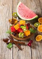 Fruit salad on table photo