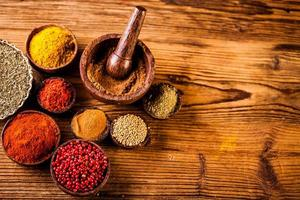 Spices in Indonesian wooden bowls photo