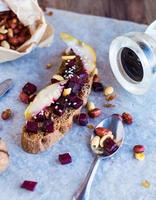 snack sandwich with roasted beets, nuts, pear and sesame