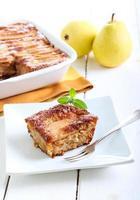 Slice of oatmeal pear cake photo