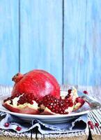 Pomegranate on a plate. photo