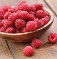Ripe red raspberries photo