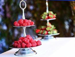 Fancy raspberries arrangement. photo