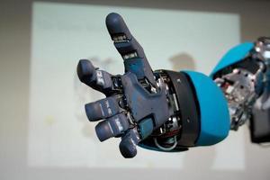 Blue robot hand will greet gloseup