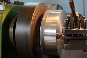 Close-up of a lathe machine at work. photo
