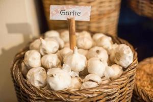 White garlic in a large basket photo
